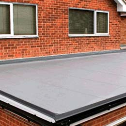 flat roofing on a brick house